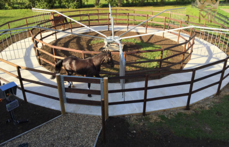 horse exerciser with wooden beams enclosure