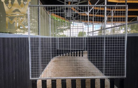 Steel and mesh pusher gate